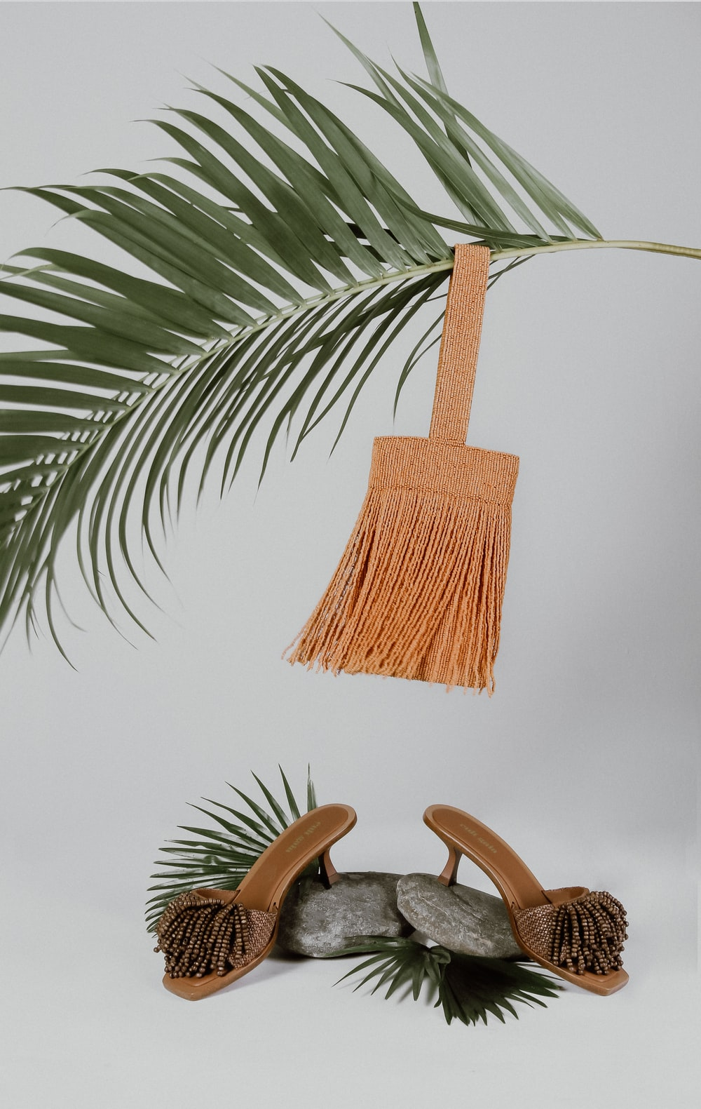 brown wooden chair near green palm tree