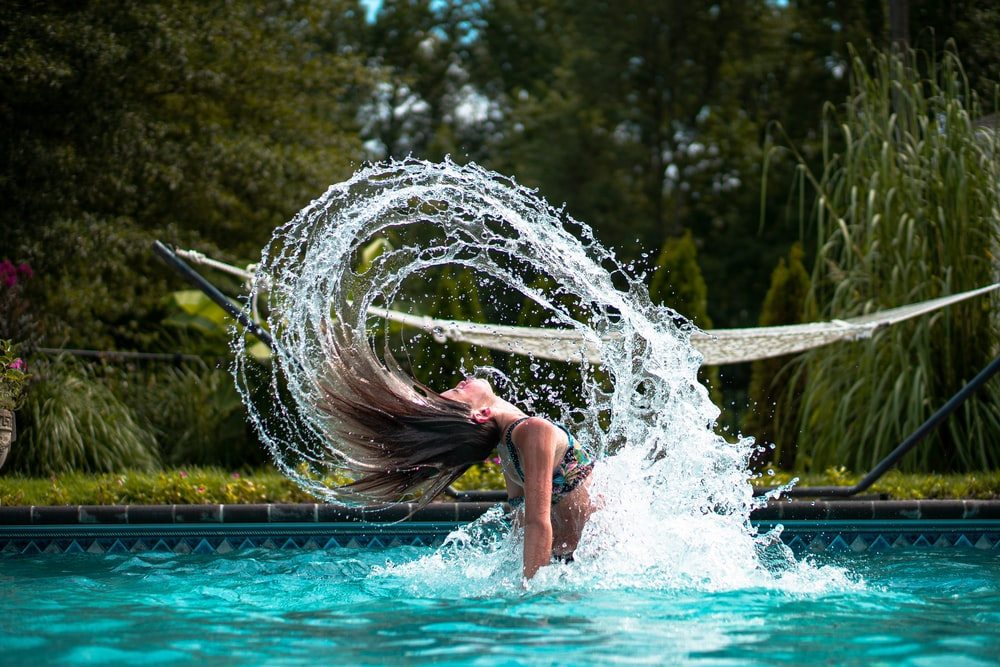 woman in swimming pool during daytime