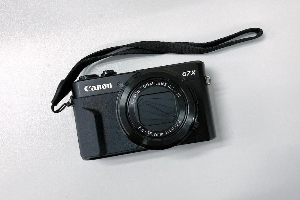 black nikon point and shoot camera
