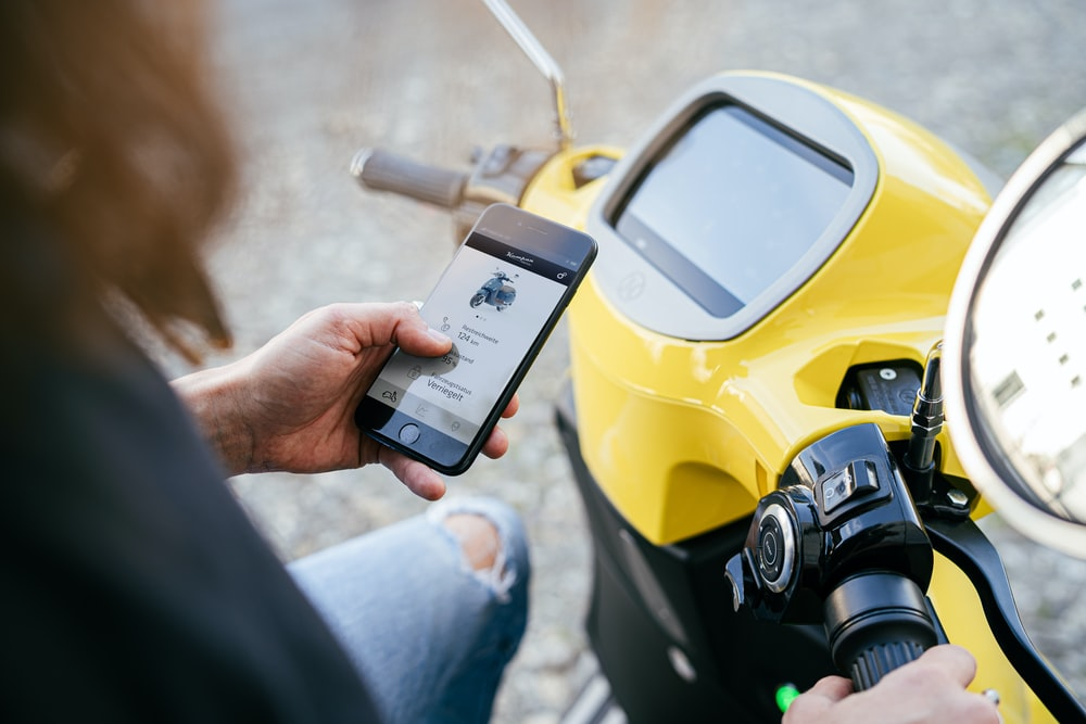 person holding yellow and black digital device