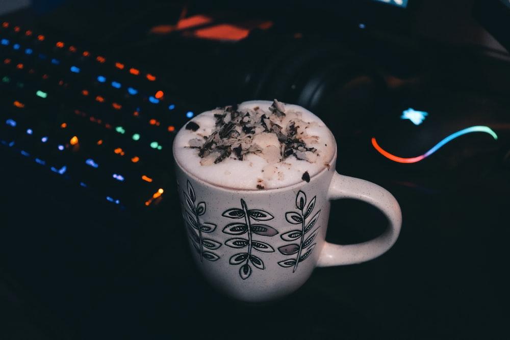 white and black ceramic mug with white and black liquid