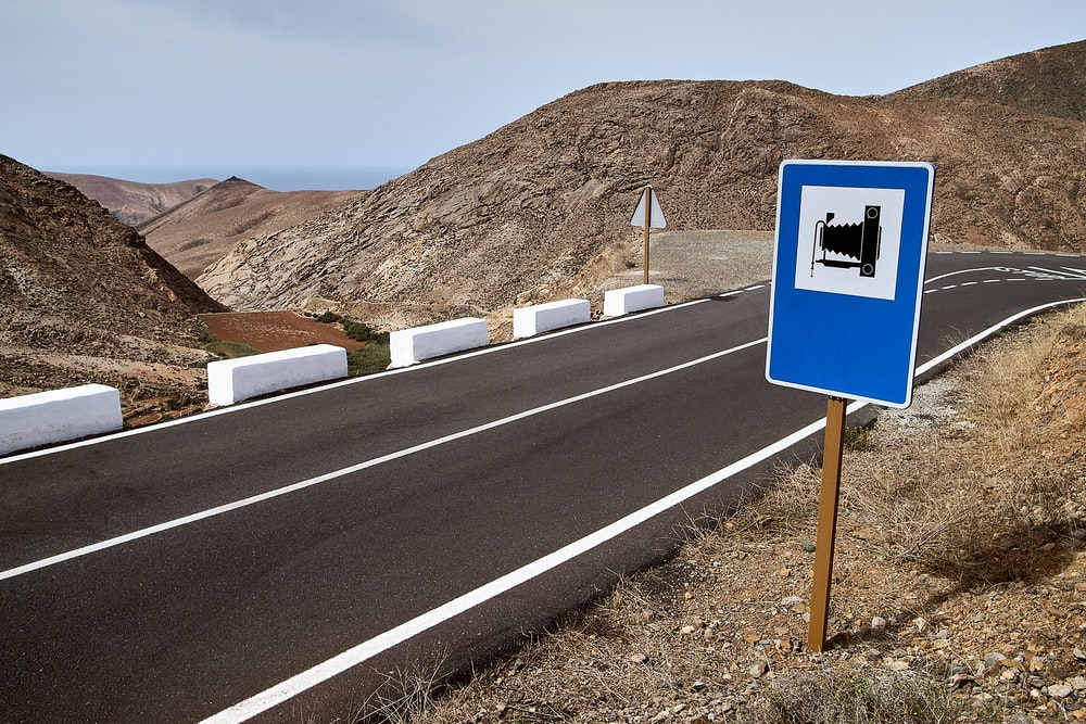 blue and white road sign