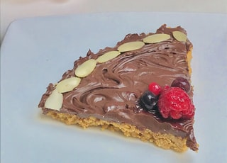 chocolate cake with strawberry on white ceramic plate