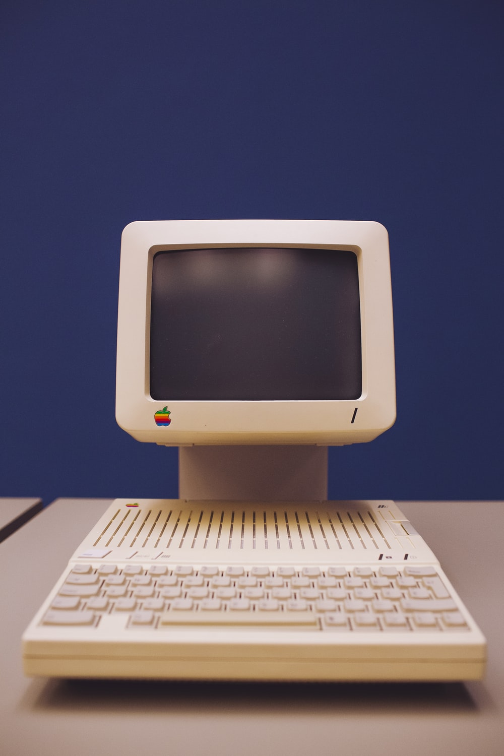 white computer monitor and white keyboard