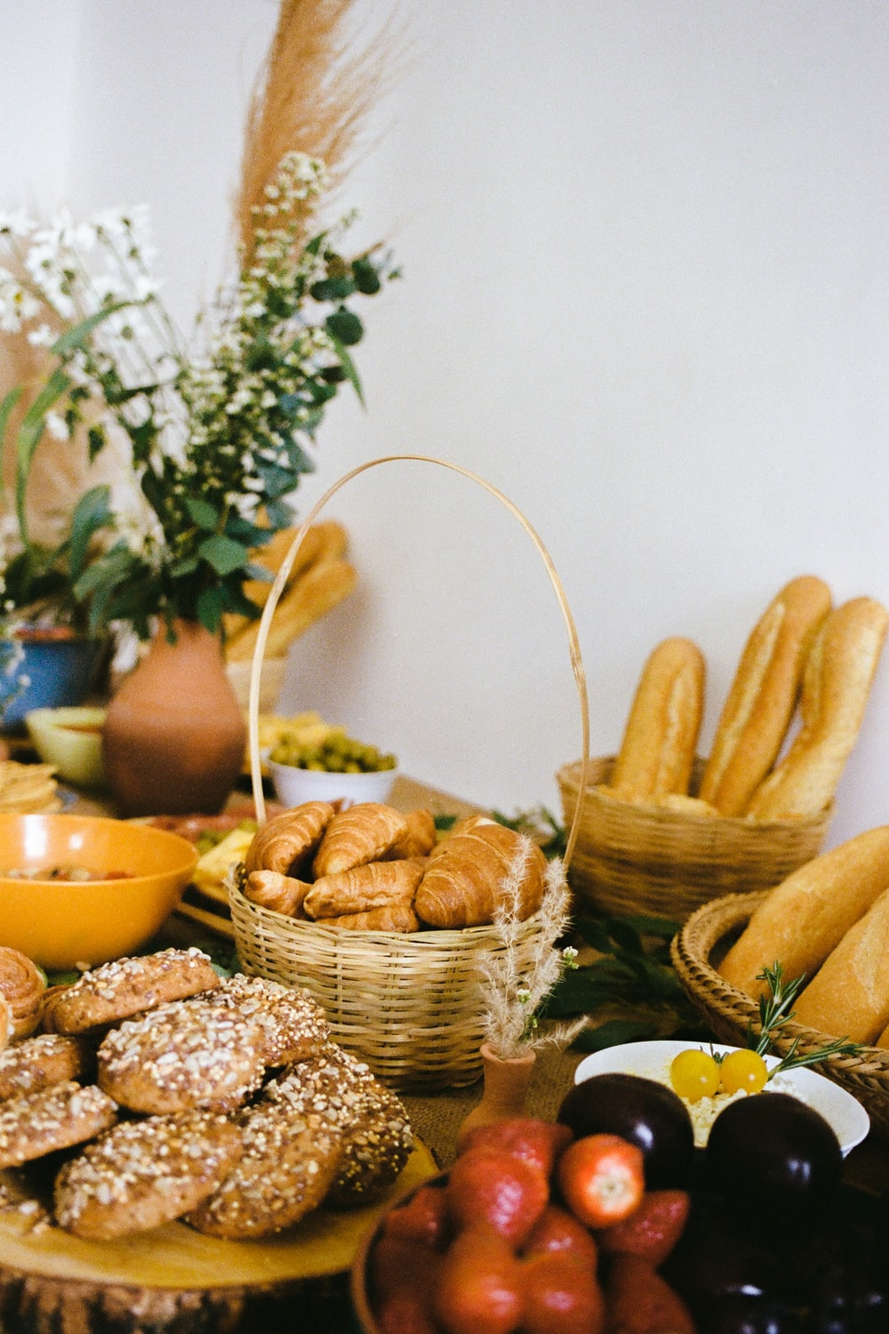 brown wicker basket with brown and yellow corns