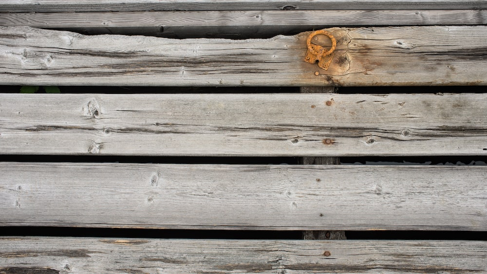 brown wooden plank with brown rope