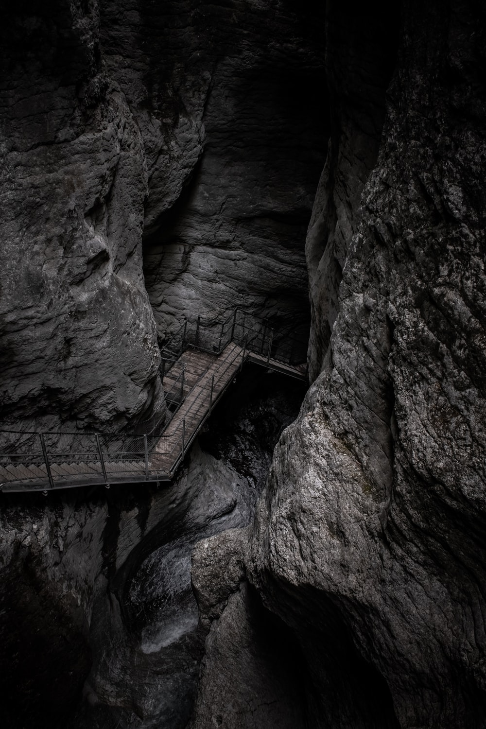 brown wooden ladder on rocky mountain