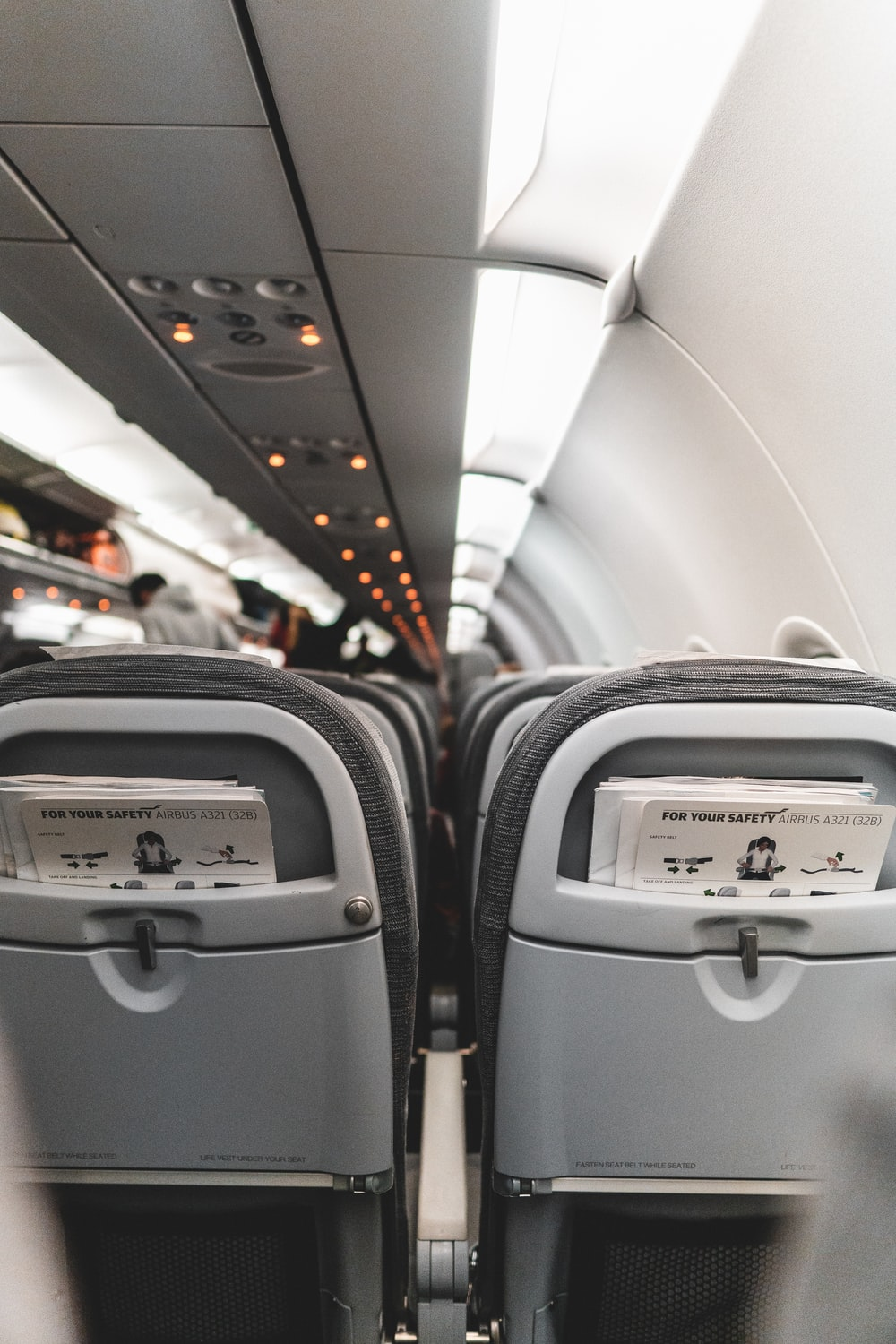 white and gray airplane seats