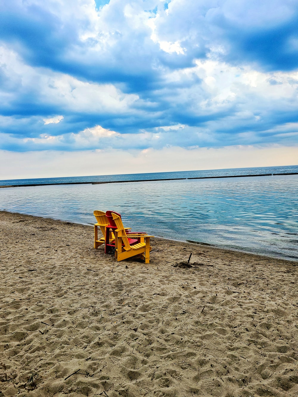 brown wooden chair on beach during daytime