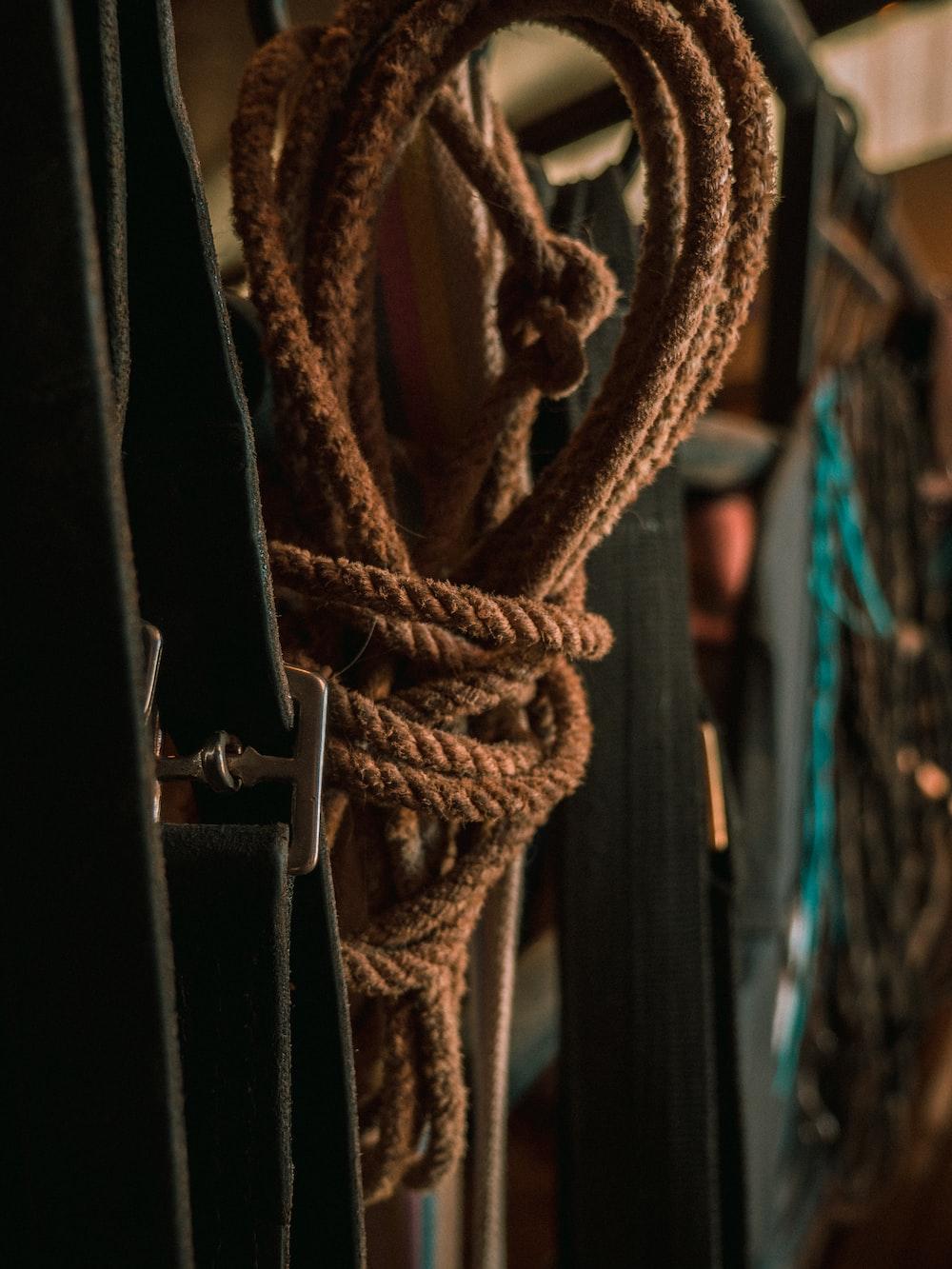 brown rope on black metal fence