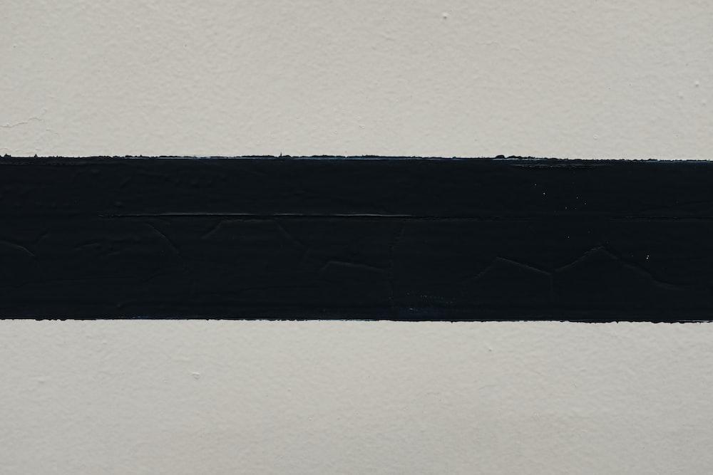 black textile on white surface