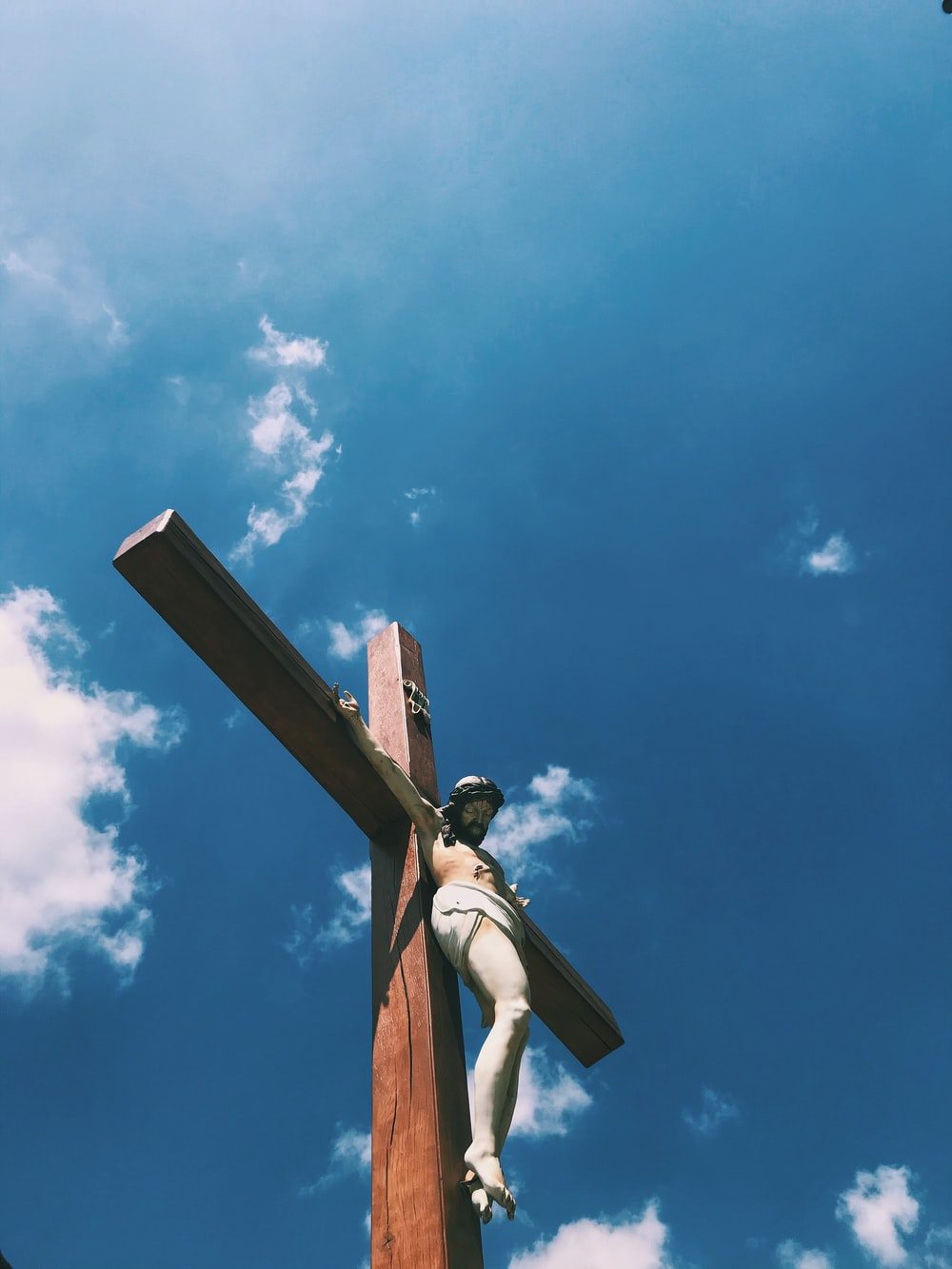 brown wooden cross under blue sky during daytime