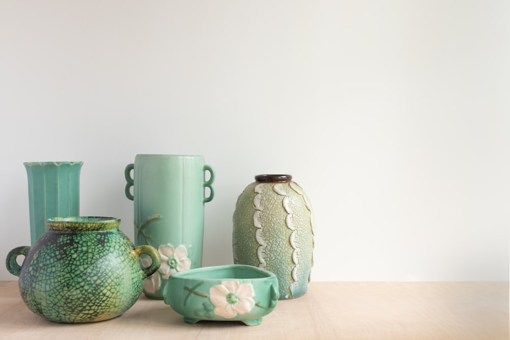 white and green ceramic floral mugs