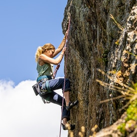 Female climbing mountain