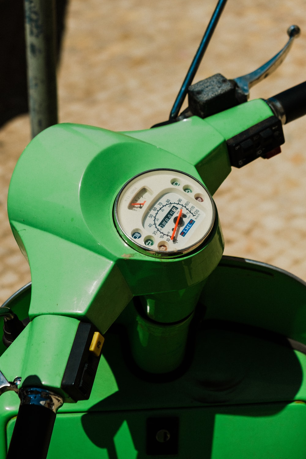 green motorcycle with white gauge