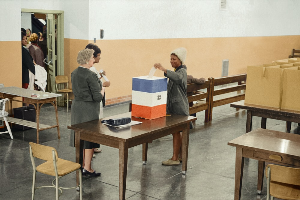 A young African American woman casting her ballot in 1964