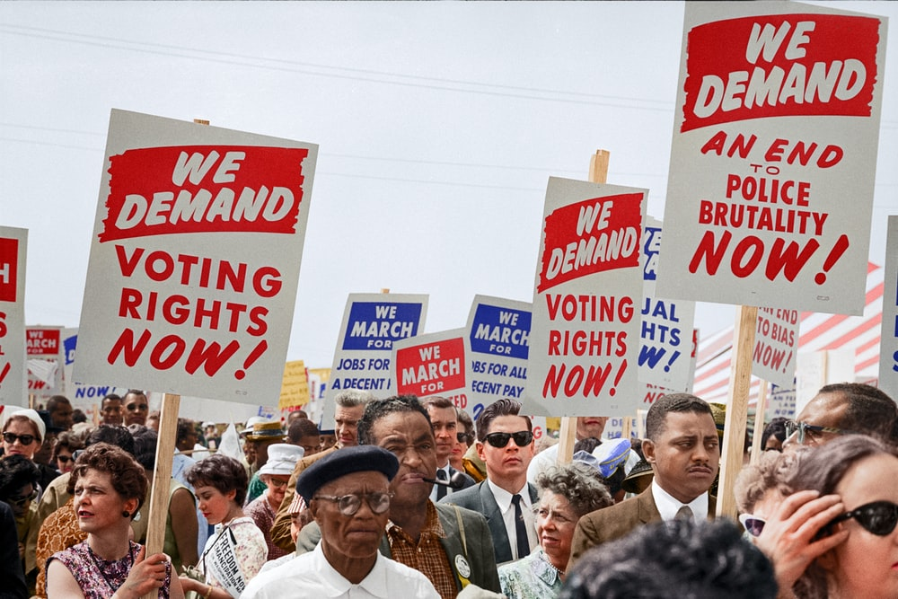Marchers holding signs demanding the right to vote at the March on Washington