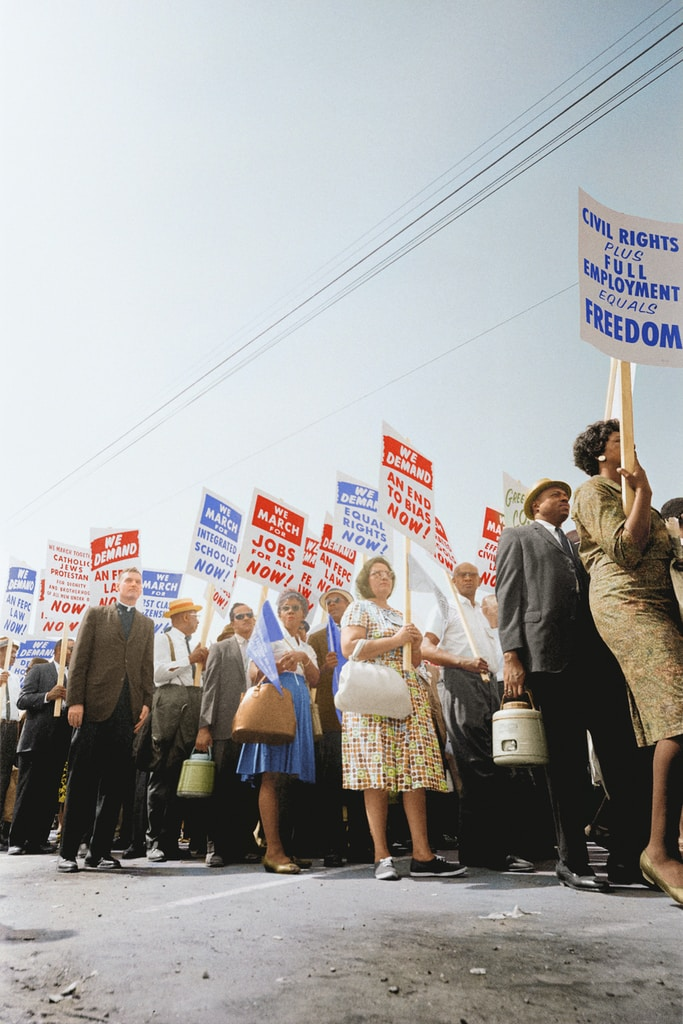 Demonstrators holding signs demanding the right to vote and equal civil rights at the March on Washington