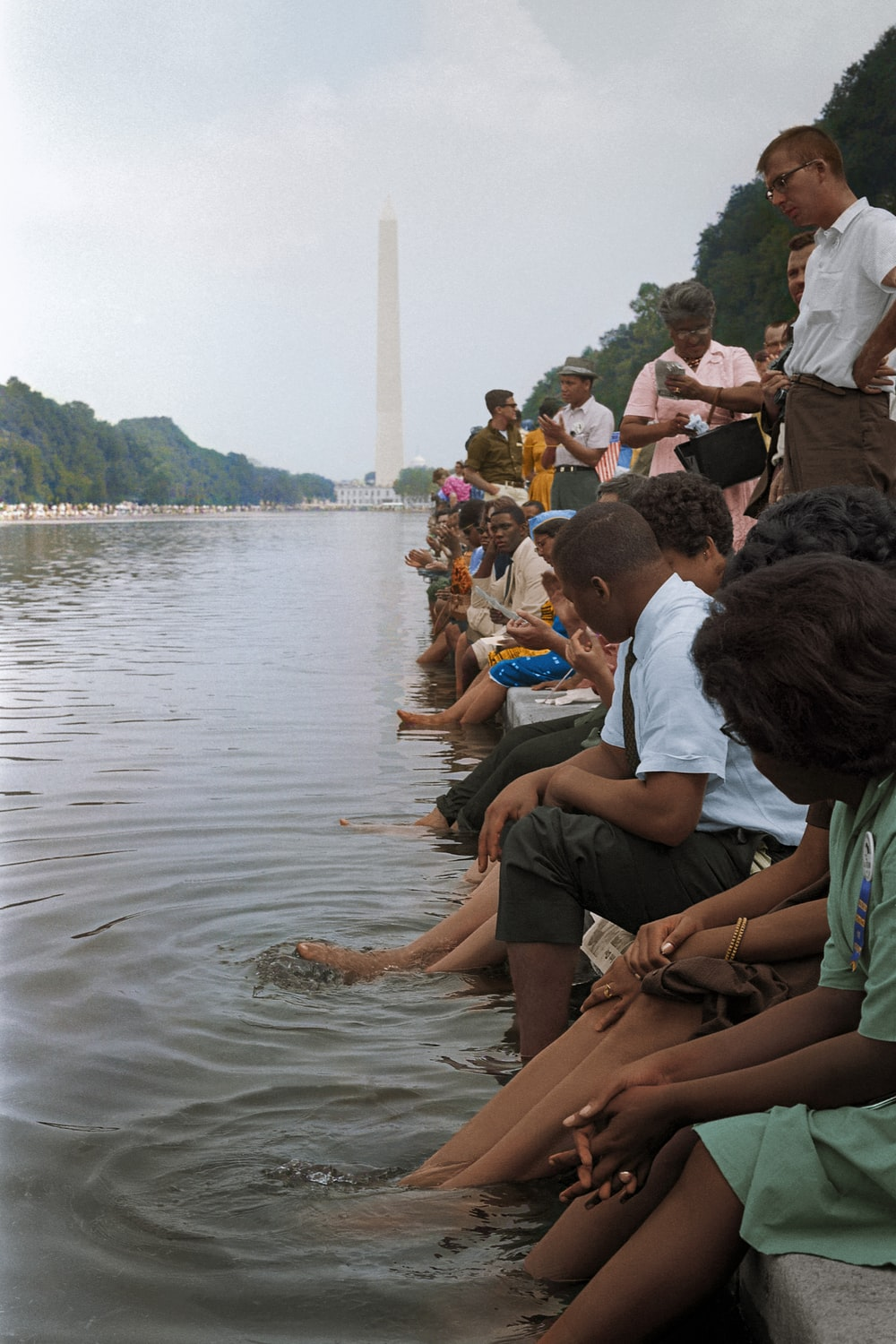 Demonstrators sit with their feet in the Reflecting Pool during the March on Washington in 1963