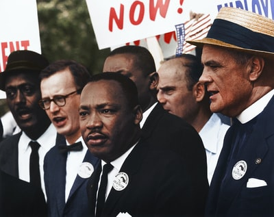 dr. martin luther king, jr. and mathew ahmann in a crowd of demonstrators at the march on washington colorized teams background