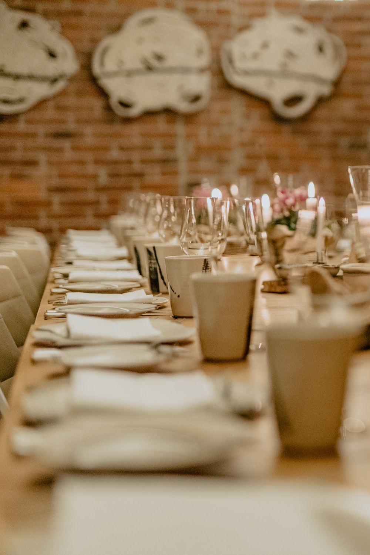 white ceramic mugs on table