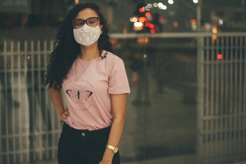 woman in white crew neck t-shirt wearing white face mask