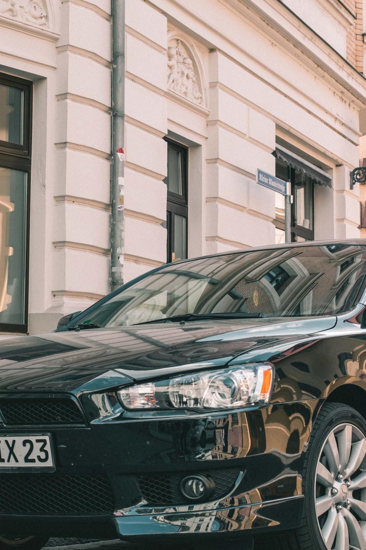 black bmw x 6 parked near building