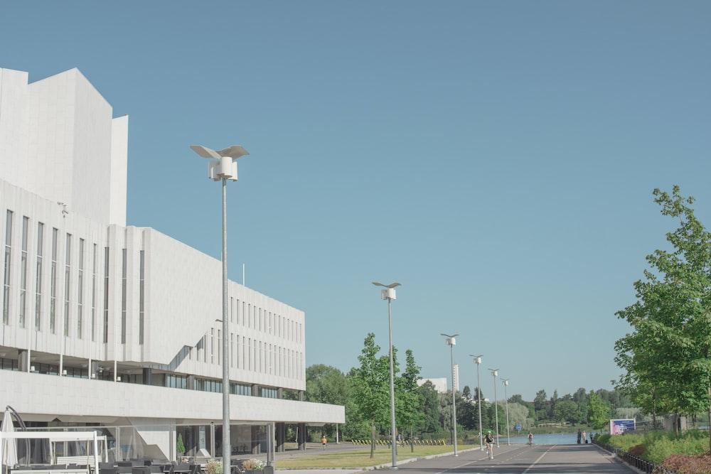 white street light near white concrete building during daytime