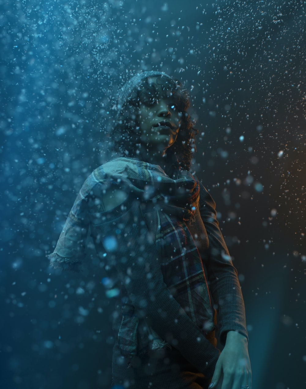 woman in blue jacket standing