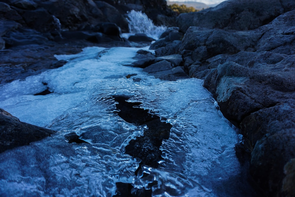 water waves on rocky shore during daytime