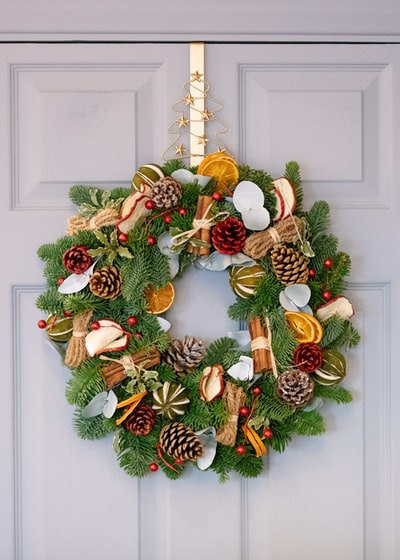 green and brown pine cone wreath