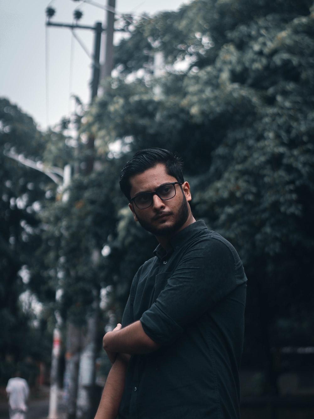 man in black long sleeve shirt wearing black sunglasses