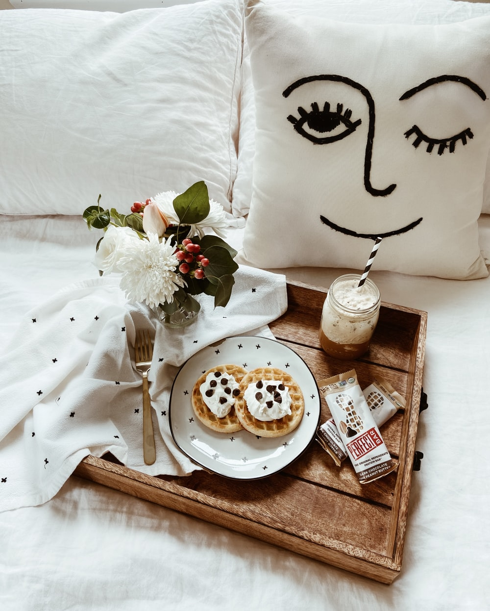 white ceramic plate with food on brown wooden tray