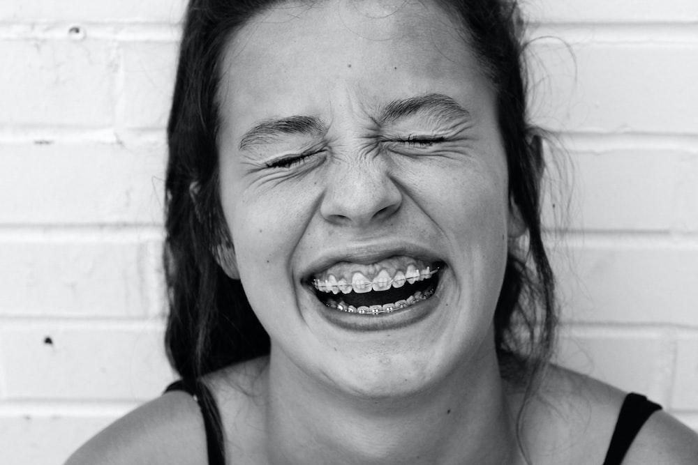 smiling woman in black tank top
