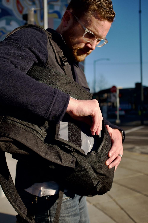 man in black jacket and black backpack
