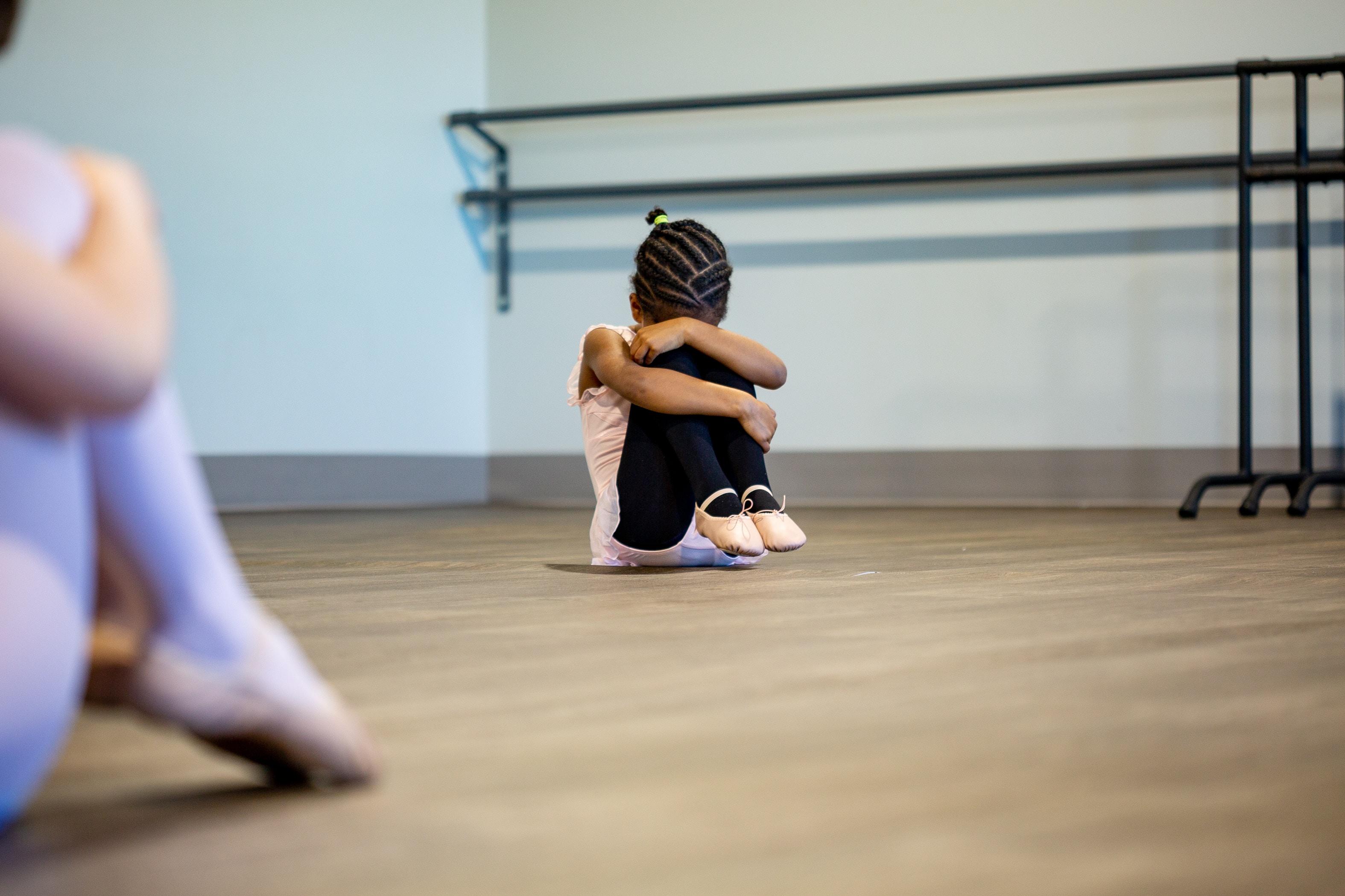 Girl performing ballet dance at a dancing studio