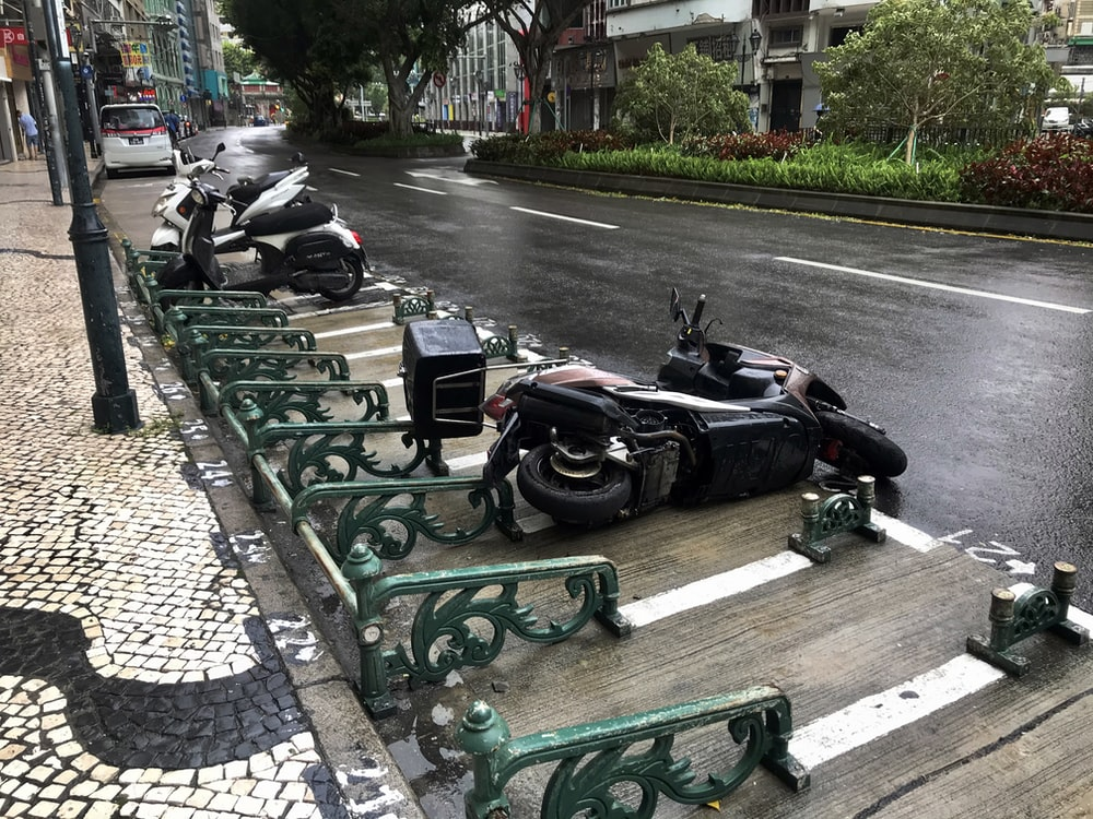 black motorcycle parked on green wooden bench