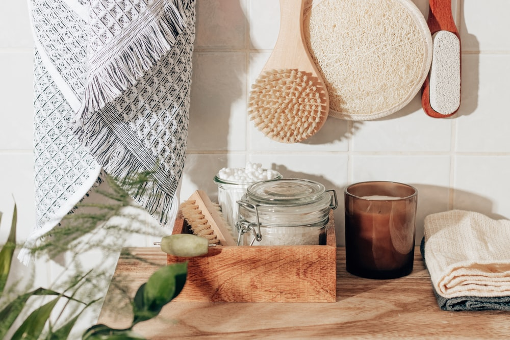 brown wooden chopping board beside clear glass jar