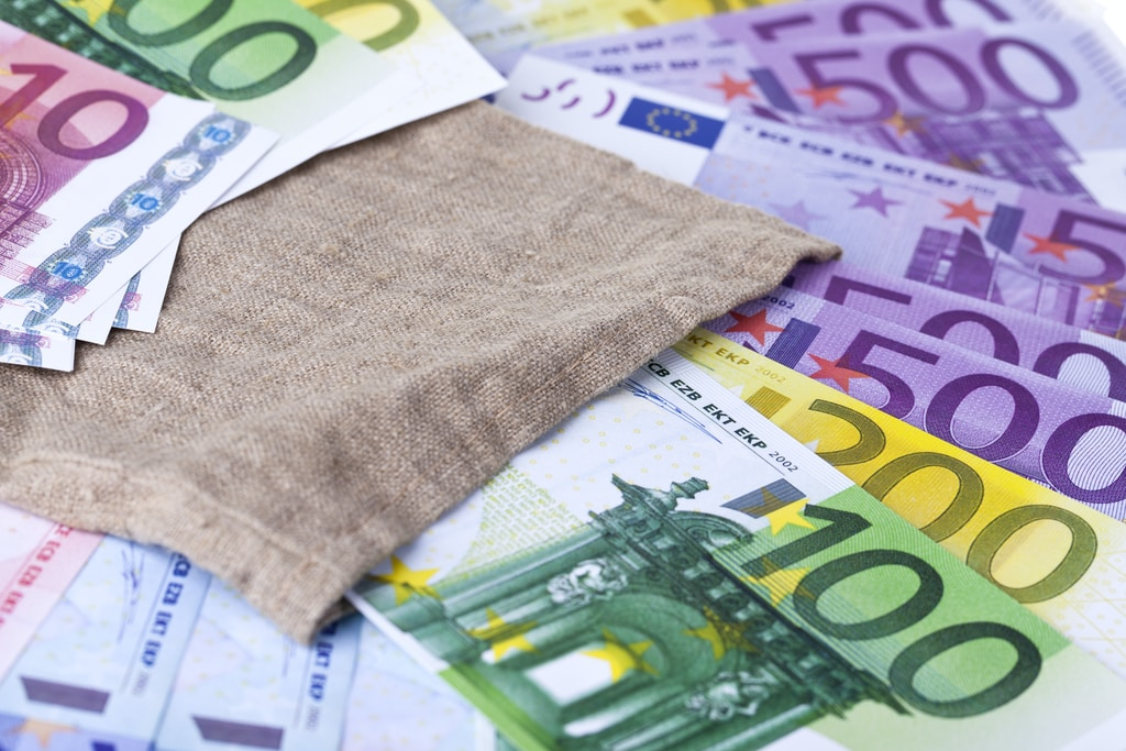 brown textile on white printer paper. Euro paper money image.