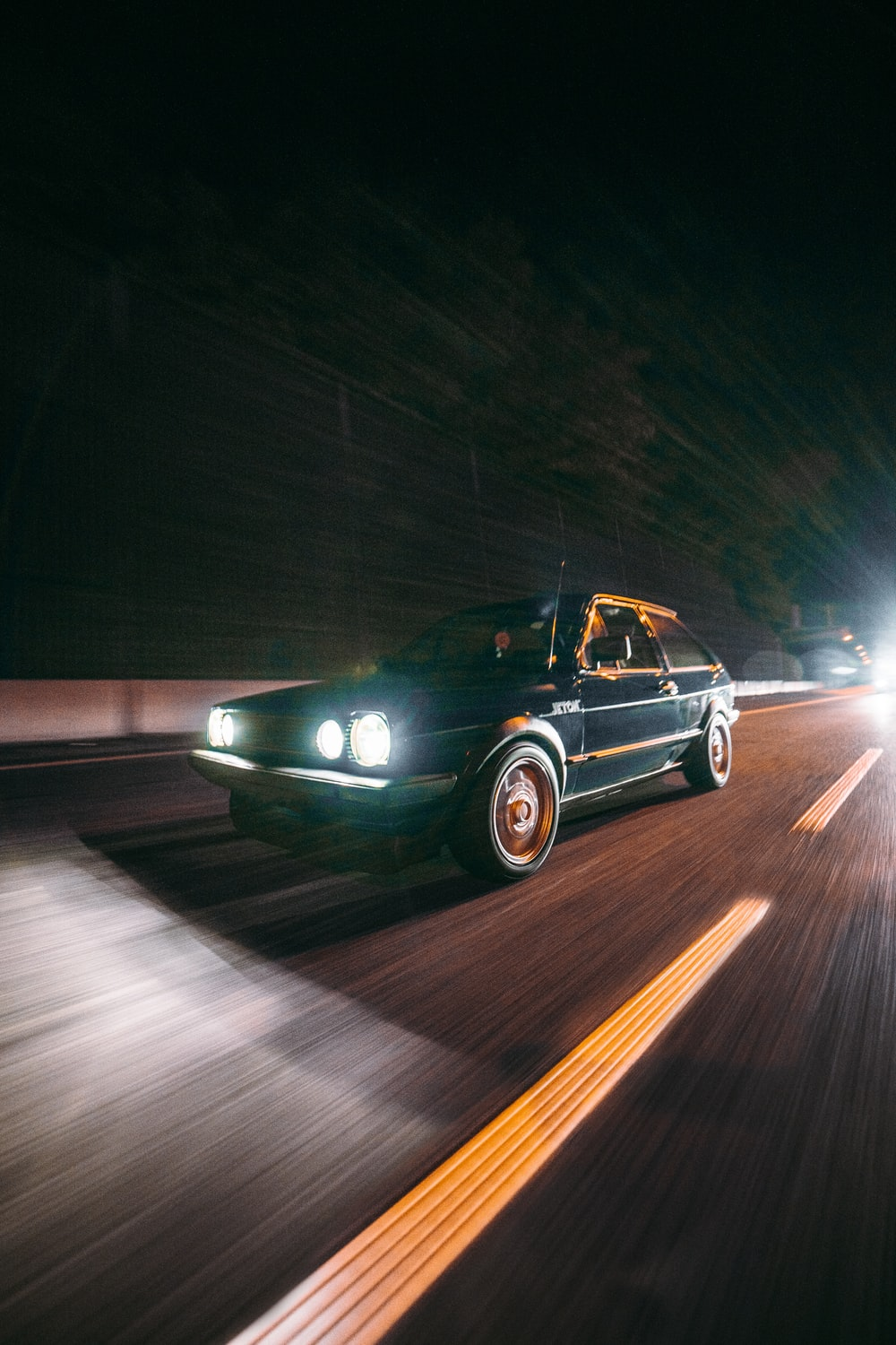 black mercedes benz coupe on road during night time