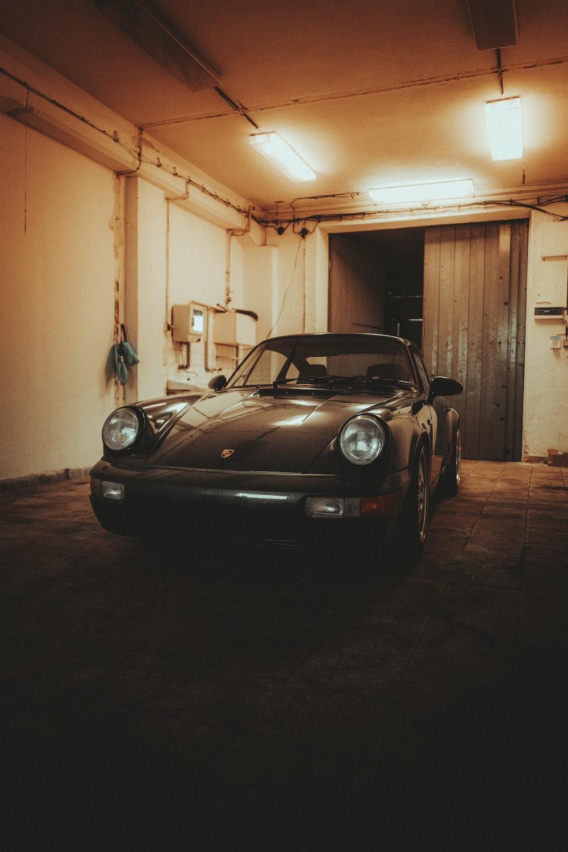 black porsche 911 parked in garage
