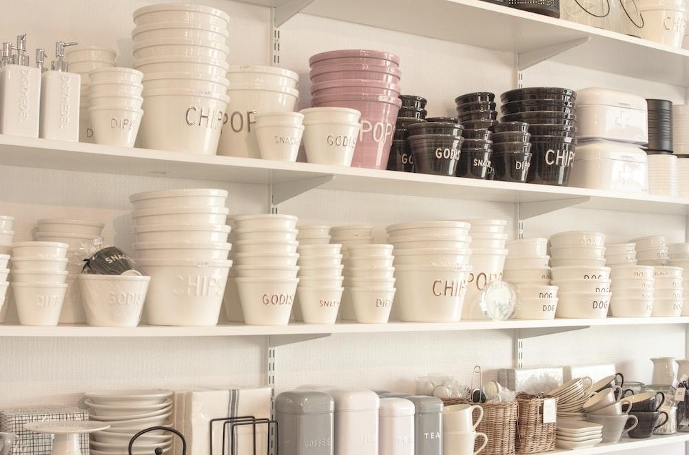 white plastic cups on white wooden shelf