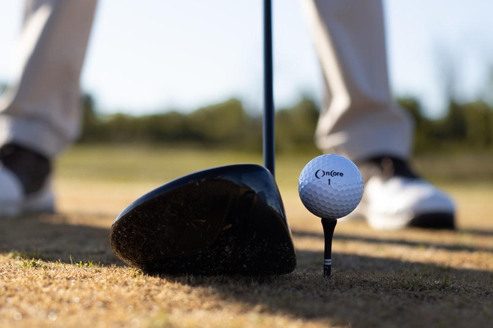 white golf ball on black golf club