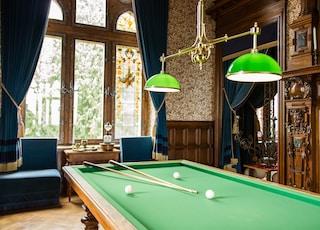 green billiard table near window