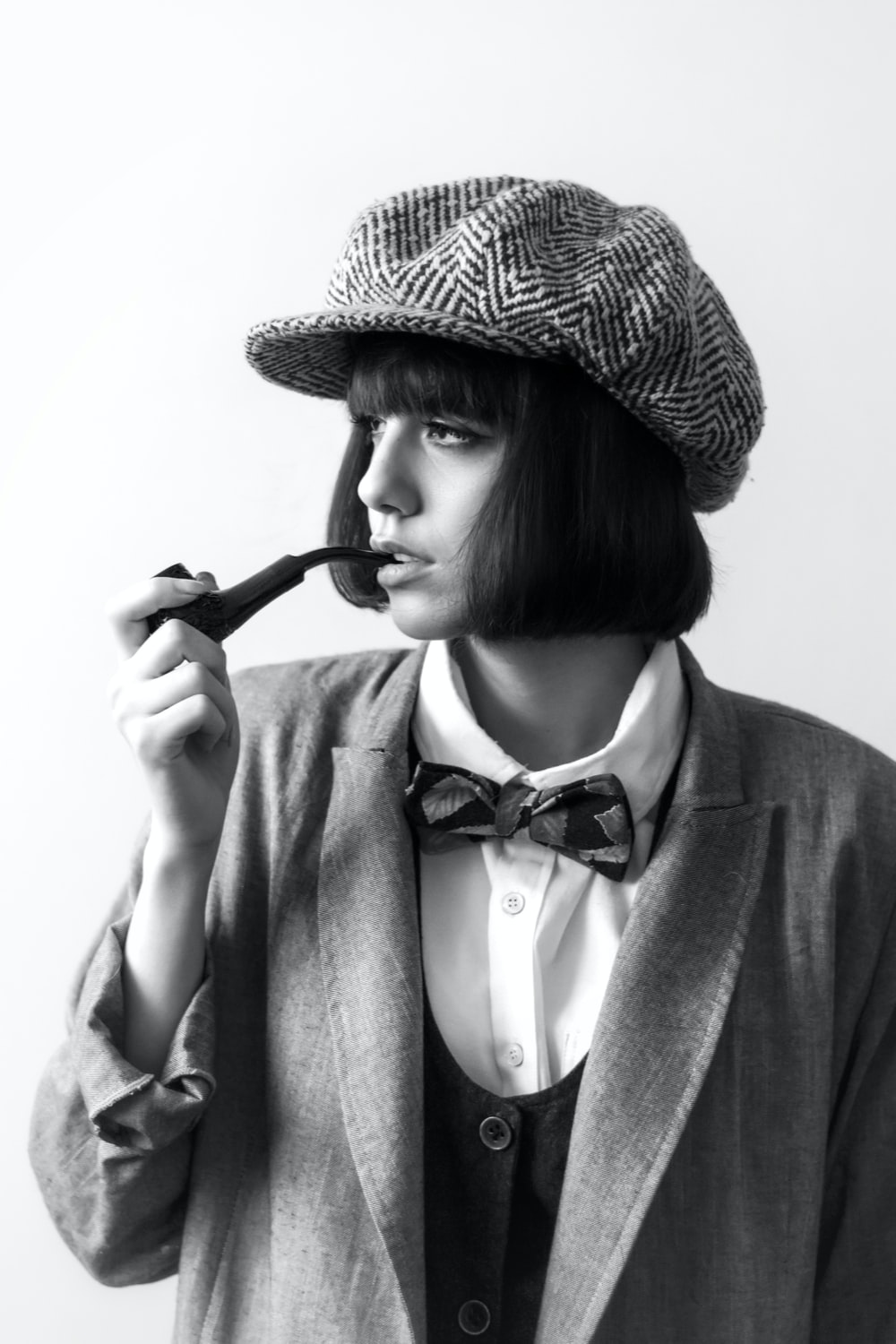 woman in black and white hat holding black and white stick