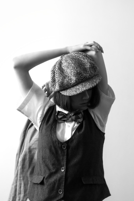 grayscale photo of woman wearing hat and sleeveless dress
