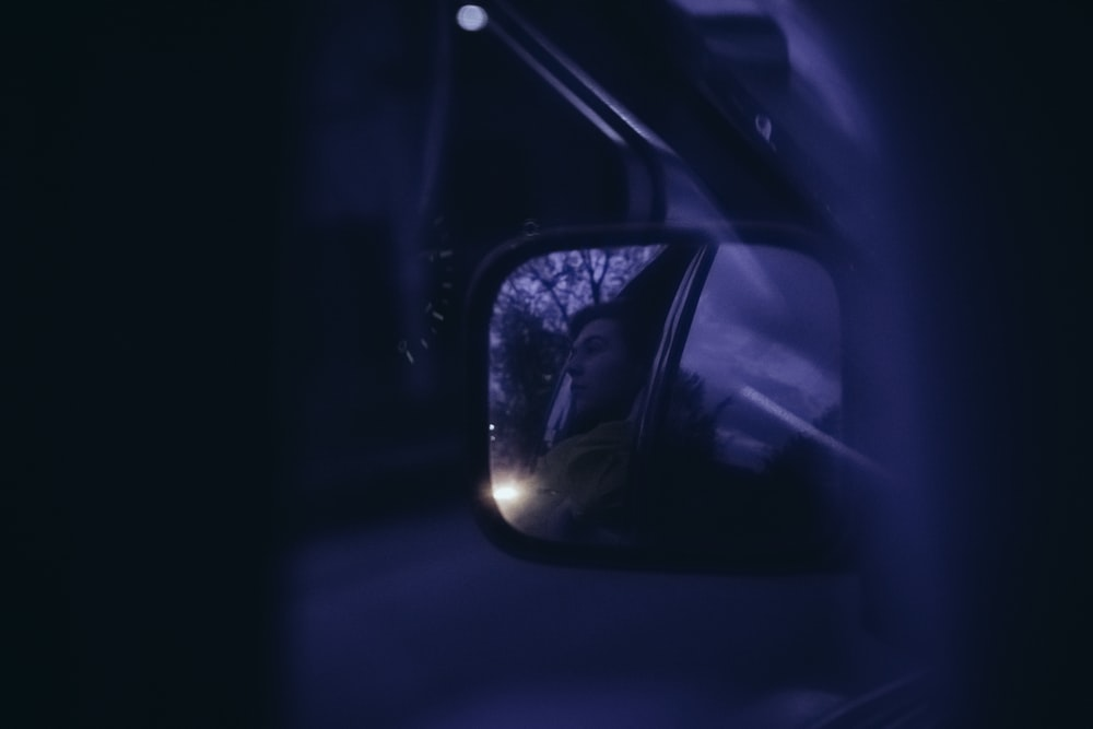 car side mirror with reflection of light
