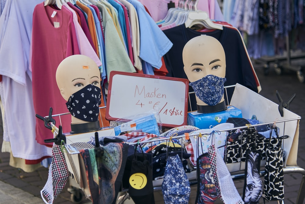 white mask beside pink and white shirts
