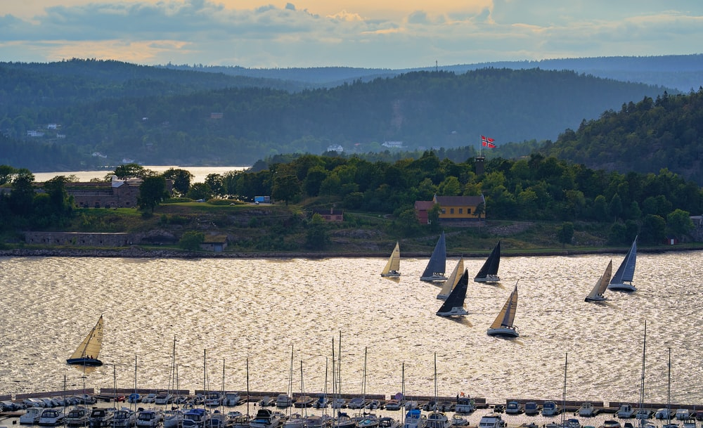 white sail boats on body of water during daytime