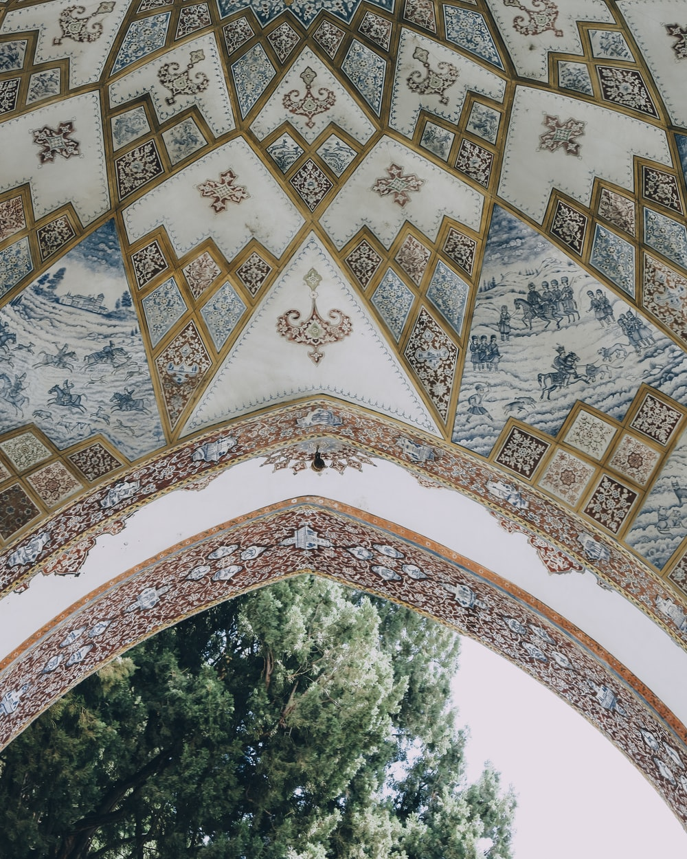 green trees under white and brown floral arch